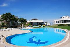 Blue Skies Above a Swimming Pool (adampanoramic) Tags: holiday swimming pool villas vacation sunshine