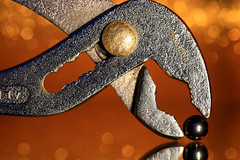 Feeding time (alideniese) Tags: macromondays pareidolia macromondayspareidolia macro closeup wrench spanner adjustablespanner tool plumbingtool silver orange bokeh light shiny metal metallic silverball reflection texture colourful colour alideniese 7dwf