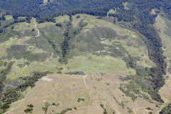 Aerial view of the San Andreas Fault, a sag pond, and a side-hill bench, Watsonville, Santa Cruz County, California (cocoi_m) Tags: aerialphotograph aerial fault sanandreasfault saf sagpond sidehillbench watsonville santacruzcounty california nature geology geomorphology green
