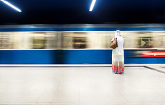 (Magdalena Roeseler) Tags: street streetphotography candid olympus colour moving train travel trainstation wait woman blue red white zuiko12mm
