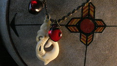 Vision Quest (Rand Luv'n Life) Tags: odc our daily challenge memento new caledonia carved fish hook cherry amber blood christ antique rosary native american medicine wheel drum painted four directions vision quest west knowledge introspection indoor composition macro