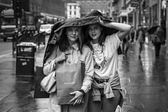 A Problem Shared... (Leanne Boulton) Tags: monochrome portrait people urban street candid portraiture streetphotography candidstreetphotography candidportrait streetportrait streetlife eyecontact candideyecontact woman women female girl face faces facial expression mother daughter family eyes look emotion atmosphere weather rain raining shower shelter tone texture detail depthoffield bokeh naturallight outdoor light shade shadow city scene human life living humanity society culture canon canon5d 5dmarkiii 70mm character ef2470mmf28liiusm black white blackwhite bw mono blackandwhite glasgow scotland uk