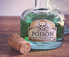 Drink me if you dare! ☠ (Through Serena's Lens) Tags: mm macromondays poisonous glass bottle liquid green coloring gnome dragon skull bones label macro 7dwf