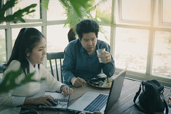 Man and woman workers talking in coffee shop (silaaa) Tags: asian chinese argue assist brainstorm business cafe coworker coffeeshop colleague company computer connection consult conversation corporate creative discussion freelance group hipster job laptop lifestyle man marketing media meeting notebook online partner people plan professional selfemployed social startup talking team teamwork technology think together woman work worker workingspace young