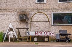 Mercer, Wisconsin Street Scene (pattyg24) Tags: mercer window wisconsin airconditioner chair grill hotdog neonsign propanetanks street stucco texture