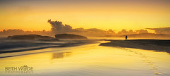 Morning Glow (Beth Wode Photography) Tags: sunrise goldensunrise beach fog fogonbeach reflections goldenglow persononbeach footprints southwestrocks midnorthcoast nsw clouds beth wode bethwode