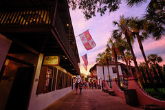 Sunset in St Augustine, Florida (` Toshio ') Tags: toshio staugustine florida usa america sunset palmtrees oldtown street shops restuarants flag people fujixe2 xe2