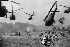 Vietnam War 1965 - Trực thăng Mỹ bắn yểm trợ cho bộ binh Nam VN tấn công một trại của VC ở 18 dặm phía bắc Tây Ninh gần biên giới Cam Bốt. (manhhai) Tags: militarycombatchoppersflighthueysoldiers tayninh vnm