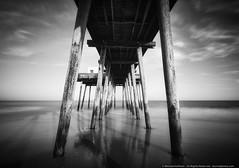 Washing the Day Away (mhoffman1) Tags: atlanticocean eastcoast laowa12mm oceancity sonyalpha a7r beach blackandwhite dramatic fishingpier longexposure monochrome ocean pier shore