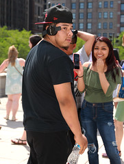 Street Portrait - Downtown Chicago - 03 Jun 2017 - 5D IV - 064 (Andre's Street Photography) Tags: chicago03jun20175div chicago millenniumpark bean downtown loop street colors gang affiliation hat cocked right representing surprise turning around girl laughing surprised look straat straatportret straatfotografie fotografi di strada streetphotography streetportrait notamused camera shy powerful physical presence head phones ball cap black red blackred canon eos 5div ef2470f4l photobyandrevanvegten chicagoist chicagojournal downtownchicago tourist destination localtourist dedeka dutchstreetphotographer chicagostreetphotography chicagostreetphotographer