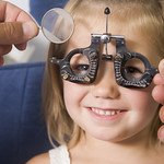 Girl having her eyesight tested by optometrist thumbnail