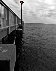Light By The Sea (Robert S. Photography) Tags: light lamp beach pier sky clouds bw coneyisland nyc brooklyn nikon coolpix l340 iso80 may 2017 selectivecolor steeplechase