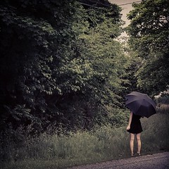 Me, standing in front of a barely recognizable abandoned house. (urbextara) Tags: ivy dark model umbrella abandonedtown abandonedvillage me overgrowth overgrown abandoned