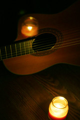 my guitar...and a flickering candle's reflection [EXPLORED] (Baking is my Zen) Tags: lightinthedarkness ourdailychallenge guitar darkness candle classicalguitar canonrebelt1i carmenortiz flickeringcandle guitarlove