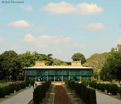 Bygone. (mohulbhowmick) Tags: canon 1300d 55mm srirangapatnam mysore karnataka india indiatraveldiaries indiapictures karnatakatourism karnatakapictures tipu palace sky clouds trees lush garden green