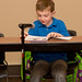 Second Grader Andrew Pilgrim reads his winning story