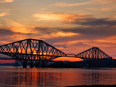Forth Bridge 2 (fraserwatson2) Tags: scotland forth bridge edinburgh fife sunset sunrise river sky clouds orange train water lumix m43