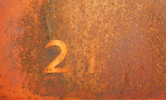 21 – So Long Ago (studioferullo) Tags: abstract art beauty bright colorful colors contrast design detail edge gold light metal minimalism old outdoor outside perspective pattern pretty rust scene study sunlight sunshine street texture tone weathered world tucson arizona countyfair number 21 brown orange yellow ocher ochre text vehicle car pima