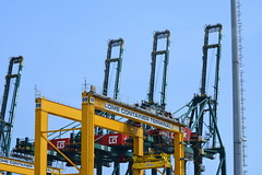 TOGO, WEST AFRICA:    LOME PORT IS A VERY ACTIVE PORT.  TOGO, AFRICA.YELLOW CRANES ON LOME'S WHARF,  TOGO,  AFRICA. (vermillion$baby) Tags: containerhoist africa crane done flickr green hoist lome pier togo wharf yellow ocean sea westafrica togosea port cranef dock transportation wharves