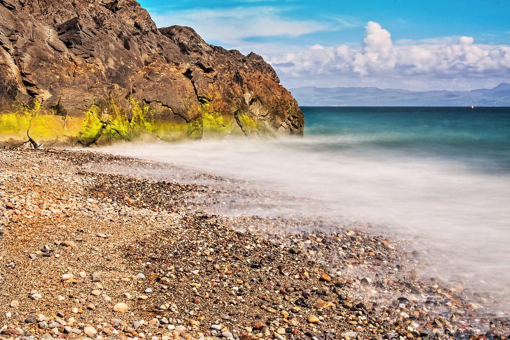 tides coming in..Gimblet rock Pwllheli
