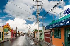 Cozumel Wet Streets (Ron Scubadiver's Wild Life) Tags: urban landscape cozumel mexico nikon sky clouds
