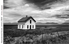 Abandoned House, Lane 6, B&W (jwvraets) Tags: colorado southwest greatsanddunesnationalpark mountains sanddunes sangredechristosrange abandonedhouse derelict clouds monochrome blackandwhite bw anseladams lane6 fence fencefriday opensource rawtherapee gimp nikon d7100 nikkor18105mmvr