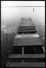 Dock (FreezerOfPhotons) Tags: canonft canonfl50mmf14 macophotup64c xtol dock wood water horizon sky reflectedsky reflections missingboards inneedofrepair