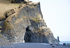 Cave by the Ocean Made of Basalt Columns (Herculeus.) Tags: 2017 april atlanticocean basalt basaltcolumns beach blacksand bouldersstonerocks country day europe iceland landscape landscapes outdoor outdoors outside reynisfjarabeach sand shoreline sightseers spring vik
