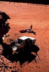 (louis de champs) Tags: minoltasrt101 agfaprecisa100 film vividcolors desert redsand rocks wadirum jordan pickup 4x4 camp camping shadows