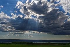 Shining a light on the land (aleadam) Tags: sun ray light cloud sky lake field afternoon spring cumulus