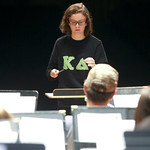 Student conducting band.