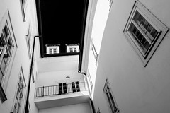Lesser Town Courtyard IV. (Tanya.Kirilova) Tags: monochrome czphoto czechrepublic prague praha blackandwhite bw architecture courtyard composition façades malástrana lessertown windows tokina1120mm nikond7100 city cityscape town geometry abstract