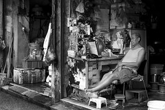 Shop keeper in front of his store, Mong Kok, Hong Kong (Job Homeless) Tags: people portrait tradition leica monotone monochorme m8 mongkok streetsnap streetphotography blackandwhite bw life living summicronm35mmf2asph