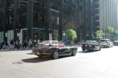 Just Ducky (Flint Foto Factory) Tags: chicago illinois urban city late spring early summer june 2017 downtown wmonroe monroe franklin intersection 1962 chevrolet chevy corvette roadster convertible morning am rushhour traffic classic american generalmotors gm sports car rag soft top moving motion inmotion black color wire wheels route66 tv television show ducktail restyle c2 last year second generation beautiful worldcars