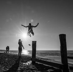 jump (Georgie Pauwels) Tags: fujifilm jump beach streetphotography public sun sunlight joy couple