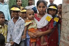 Bulawa tolis take children to the Islamia School polio booth in Bada Bazaar area of Mainpuri...UNICEF India/2010/Gurinder Osan.. (unicefindia) Tags: 6to11yearsold boy diseaseprevention girl grouppeople india infantsunder1year poliomyelitis