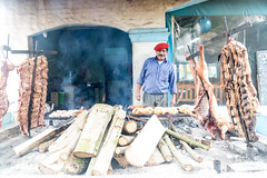 At the Grill - La Posta de Arequito - San Antonio de Areco (BlueVoter - thanks for 1.7M views) Tags: sanantoniodeareco parilla asador grill beret