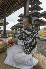 Women's work (tmeallen) Tags: woman weaving womenswork palmleaves religiousofferings merus traditionalattire purapenataranagung hindutemple purabesakih bali indonesia