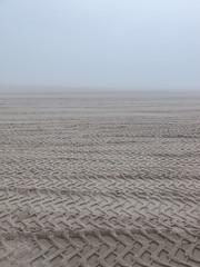 A beach! (Tim Kiser) Tags: 2013 20130528 greatlakes img2527 lakemichigan lakemichiganbeach may may2013 michigan michiganlandscape muskegon muskegoncounty muskegoncountymichigan muskegonmichigan muskegonlandscape peremarquettepark beach beachlandscape beachsand fog foggylandscape landscape sand tiretracks tiretracksinsand tiretracksonabeach view westmichigan westernmichigan unitedstates us txtchg