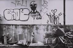 Humans Are Boring (35mm) (jcbkk1956) Tags: bangkok thailand street thonglo ekkamai wall graffiti bike bicycle contax 167mt analog manualfocus ilford pan100 35mm mono blackwhite carlzeiss 45mmf28 alien worldtrekker