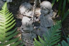 SWINGING AMONG THE FERNS (kelsey61) Tags: garden landscaping plants plant yard gardenornaments fern ferns gardenstatuary