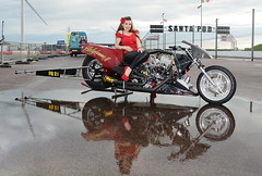 Holly_3521 (Fast an' Bulbous) Tags: dragbike bike motorcycle fast speed power drag strip race track pits nitro girl woman hot sexy model pinup long brunette hair high heels stilettos red shoes leather pvc leggings puddle reflection