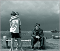 Loneliness (sabpost) Tags: grandfather grandpa lonely old couple pensive sad sea street photo