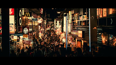 Takeshita-dori, Tokyo, Japan (emrecift) Tags: cityscape night low light street photography crowd tokyo japan cinematic 2391 anamorphic sony a7 alpha legacy lens glass canon new fd 50mm f14 emrecift
