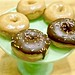 five glazed donuts on display