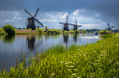 Windmills, Passing Squall (ben_leash) Tags: wi windmill squall cloudy gray green kinderdijk netherlands nederland landscape stormy river waterway