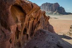 Eye of the rock (LynxDaemon) Tags: jordan desert wadirum sand red dry mountain rocks old shadows