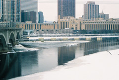 Mississippi in the Winter 1 (vdezutti) Tags: 35mm film minneapolis minnesota color twin cities city midwest mississippi river bridge hennepin stone arch belt beer neon sign winter grain northeast downtown vivitar v335