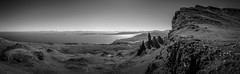 The Old Man of Storr in BW Panorama (Niklas FliNdt) Tags: old man storr highlands scotland isle skye sun sky blue no clouds noclouds attraction sightseeing sight mountain hiking outdoor travel roadtrip island ocean atlantic high sunny bright panorama monochrome bw black white bnw