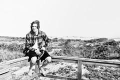 My Brother the 1990s Rocker (mmockingbird) Tags: assateague blackandwhite beach boardwalk island hiking hike marsh portrait sand dunes